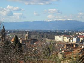 "Florence - panoramic view of the ""Santo Spirito"" church and the snow covered Apenninic ridge"